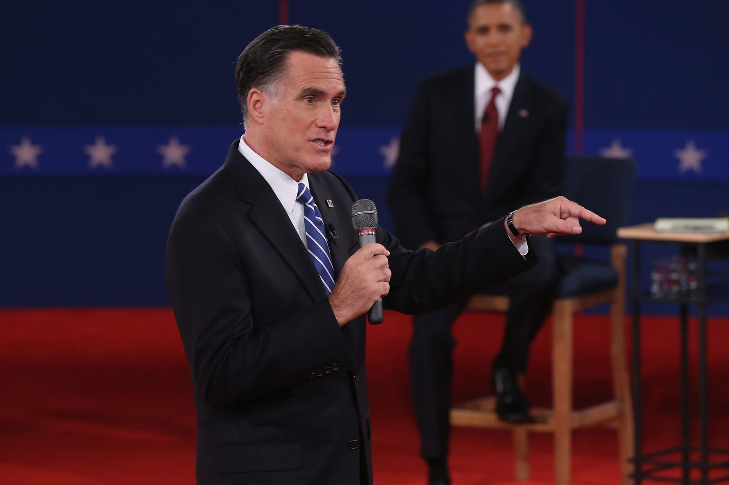 HEMPSTEAD, NY - OCTOBER 16:  Republican presidential candidate Mitt Romney (L) speaks as U.S. President Barack Obama listens during a town hall style debate at Hofstra University October 16, 2012 in Hempstead, New York. During the second of three presidential debates, the candidates fielded questions from audience members on a wide variety of issues.  (Photo by Spencer Platt/Getty Images)