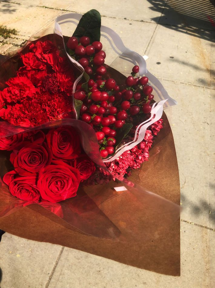 A Chic Flower Arrangement In Four Shades Of Red
