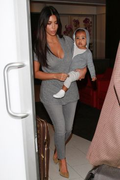Kim Kardashian takes baby North West on late night flight from LAX Airport in Los Angeles, CA, on August 10, 2014.<P>Pictured: Kim Kardashian and North West<P><B>Ref: SPL818176  100814  </B><BR/>Picture by: Diabolik / Splash News<BR/></P><P><B>Splash News and Pictures</B><BR/>Los Angeles:310-821-2666<BR/>New York:212-619-2666<BR/>London:870-934-2666<BR/>photodesk@splashnews.com<BR/></P>
