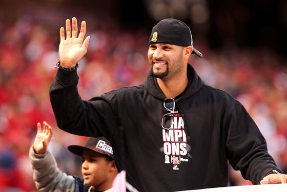 ST. LOUIS, MO - OCTOBER 30: First baseman Albert Pujols of the St. Louis Cardinals waves to the crowd during the World Series victory parade for the franchise's 11th championship on October 30, 2011 in St Louis, Missouri. (Photo by Ed Szczepanski/Getty Images)
