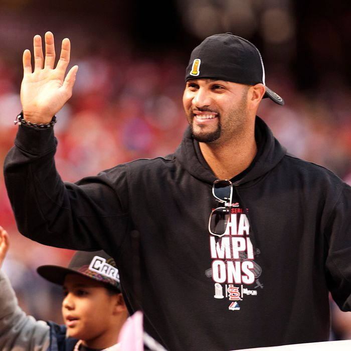 First baseman Albert Pujols of the St. Louis Cardinals waves to the crowd during the World Series victory parade for the franchise's 11th championship on October 30, 2011 in St Louis, Missouri.