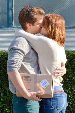 Beverly Hills, CA - Young Hollywood couple Emma Stone and Andrew Garfield share a perfect moment with our photographer while out in Beverly Hills running errands. 'The Amazing Spider-man' British star is seen carrying a L.L.Bean box while his cute girlfriend had her hands wrapped around his neck for a tight grip.