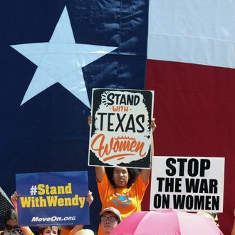 AUSTIN, TX - JULY 01: Supporters of Texas women's right to reproductive decisions rally at the Texas State capitol on July 1, 2013 in Austin, Texas. This is first day of a second legislative special session called by Texas Gov. Rick Perry to pass an restrictive abortion law through the Texas legislature. The first attempt was defeated after opponents of the law were able to stall the vote until after first special session had ended.