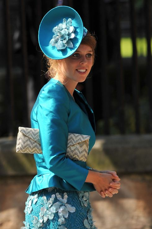 Princess Beatrice arrives for the wedding between England rugby player Mike Tindall and Zara Phillips, the eldest granddaughter of Britain's Queen Elizabeth, at Canongate Kirk in Edinburgh, Scotland July 30, 2011. The couple, both world-beating sports stars, tie the knot at Edinburgh's Canongate Kirk in a private ceremony mid-afternoon that has little in common with that of Phillips' cousin, Prince William, when he married the former Kate Middleton three months ago.   AFP PHOTO / BEN STANSALL (Photo credit should read BEN STANSALL/AFP/Getty Images)