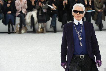 Designer Karl Lagerfeld acknowledges the applause of the audience after the Chanel Ready to Wear Fall/Winter 2012/2013 show at Grand Palais in Paris, as part of Paris Fashion Week.
