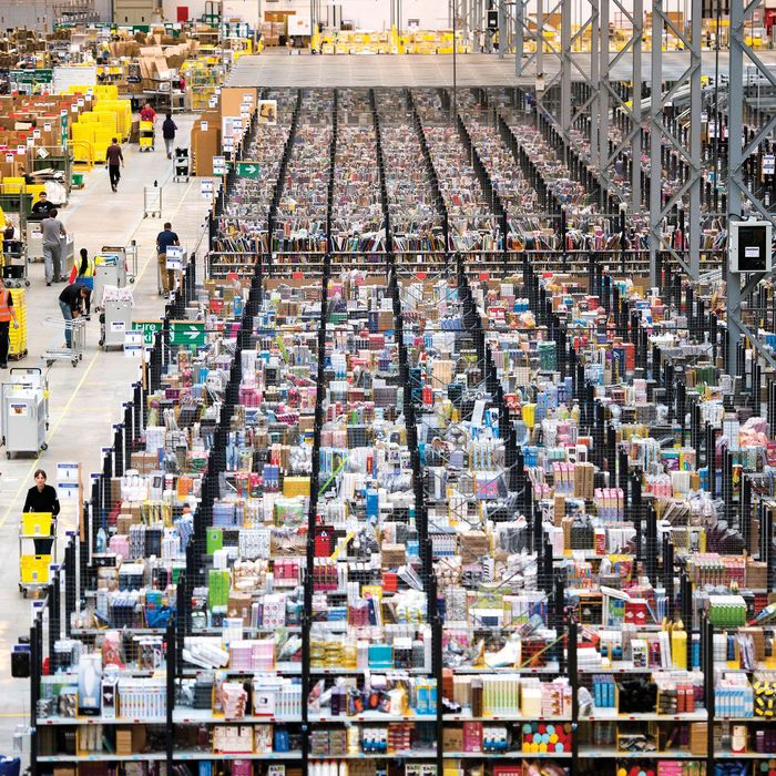 28/11/2013. Peterborough, UK. An aerial view of items on shelves waiting to be distributed. Staff at the Amazon Peterborough fulfilment centre process orders as they prepare for 'Cyber Monday', busiest online shopping day of the year. On Cyber Monday 2012, Amazon.co.uk saw more than 3.5 million items ordered on the site, at a rate of around 41 items per second. Over 15000 extra staff are drafted in to Amazon nation wide over the festive period to cope with the extra demand with over 1000 extra staff being deployed at the Peterborough site. Photo credit: Ben Cawthra / eyevineContact eyevine for more information about using this image:T: +44 (0) 20 8709 8709E: info@eyevine.comhttp://www.eyevine.com