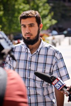 Najibullah Zazi, 24, arrives at the Byron G. Rogers Federal Building in downtown with his attorney Art Folsom (not pictured) September 17, 2009 in Denver, Colorado. Zazi has been undergoing questioning at the FBI's Denver branch for suspected involvement in a terrorism plot involving peroxide-based explosives. Federal and local authorities searched Zazi's apartment and the home of relatives close by yesterday but have not commented on whether anything was found during the searches. Zazi has repeatedly denied being involved with terrorism or bomb making.