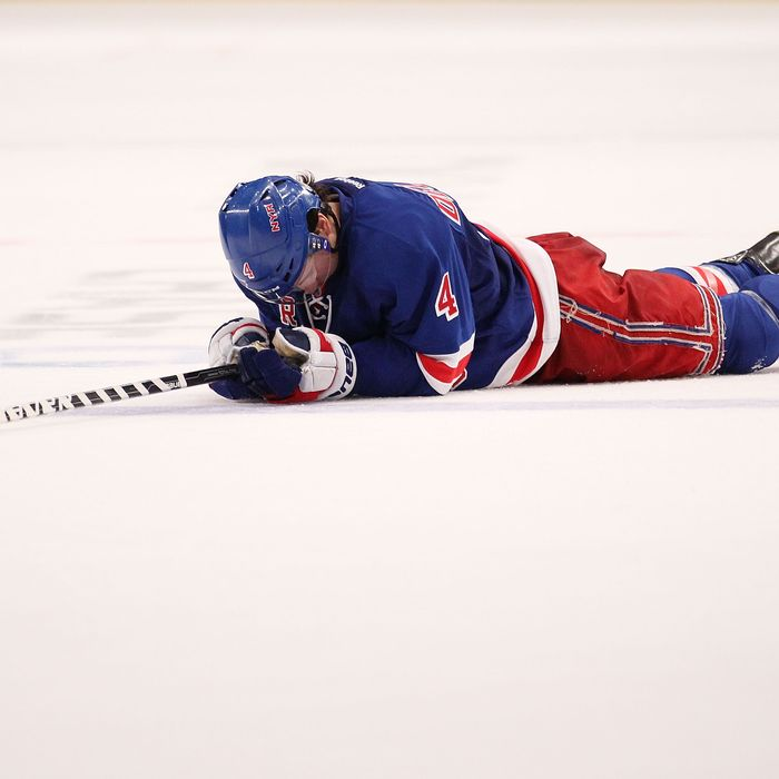 NEW YORK, NY - MARCH 17: Michael Del Zotto #4 of the New York Rangers lays on the ice after the loss to the Colorado Avalanche at Madison Square Garden on March 17, 2012 in New York City. (Photo by Nick Laham/Getty Images) *** Local Caption *** Michael Del Zotto