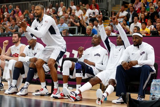 LONDON, ENGLAND - JULY 29:  Tyson Chandler #4 and Kobe Bryant #10 of United States cheer on their teammates against France in the Men's Basketball Game on Day 2 of the London 2012 Olympic Games at the Basketball Arena on July 29, 2012 in London, England.  (Photo by Jamie Squire/Getty Images)