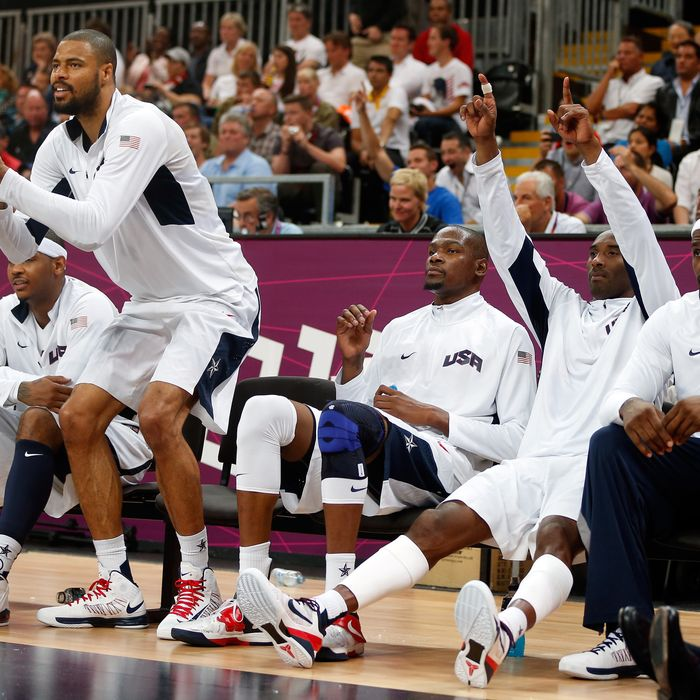 Tyson Chandler #4 and Kobe Bryant #10 of United States cheer on their teammates against France in the Men's Basketball Game on Day 2 of the London 2012 Olympic Games