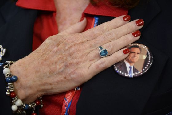 A woman holds her hand to her heart during the US National Anthem at the start of the third session of the Republican National Convention at the Tampa Bay Times Forum in Tampa, Florida, USA, 29 August 2012. Vice Presidential running mate Paul Ryan will be the featured speaker for the session.