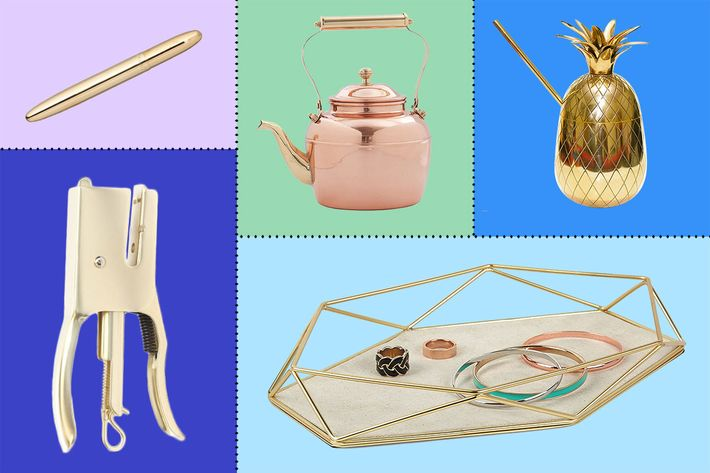 collage of fisher space brass bullet pen, zyyz ware brass pineapple mug, kikkerland dog stapler, old dutch copper teakettle, umbra prisma jewelry tray - strategist best home decor and best brass things on amazon