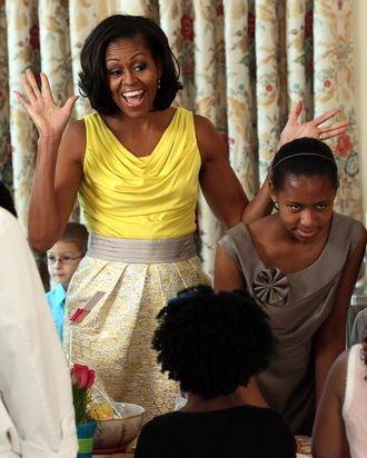 WASHINGTON, DC - MAY 10: U.S. first lady Michelle Obama participates in honoring the upcoming Military Spouse Appreciation Day and in support of military families celebrating Mother's Day during an event in the State Dining Room at the White House May 10, 2012 in Washington, DC. Obama and Dr. Jill Biden began by hosting a Joining Forces Mother's Day event for three generations of military families and military mothers, as well as participating in a Joining Forces service to provide care packages to military mothers who have loved ones serving abroad. (Photo by Win McNamee/Getty Images)