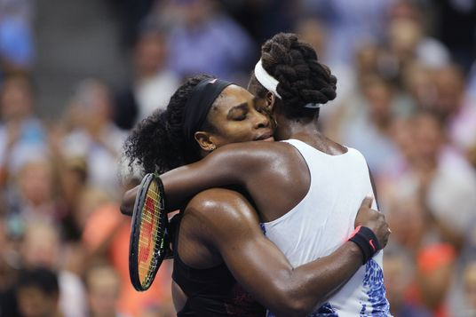 Serena Williams, USA and sister Venus Williams, USA, embrace after in their Women's Singles Quarterf