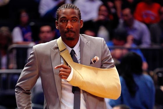 NEW YORK, NY - MAY 03:  Amare Stoudemire #1 of the New York Knicks wears a sling on his left arm due to a cut on his hand against the Miami Heat in Game Three of the Eastern Conference Quarterfinals in the 2012 NBA Playoffs on May 3, 2012 at Madison Square Garden in New York City.  NOTE TO USER: User expressly acknowledges and agrees that, by downloading and or using this photograph, User is consenting to the terms and conditions of the Getty Images License Agreement.  (Photo by Jeff Zelevansky/Getty Images)