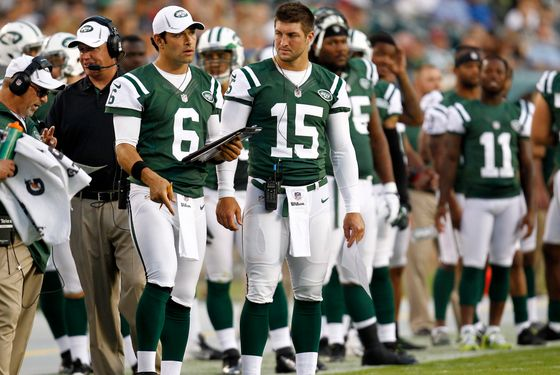 PHILADELPHIA - AUGUST 30:  Mark Sanchez #6 (L) and Tim Tebow #15 of the New York Jets stand on the sidelines during their preseason game against the Philadelphia Eagles at Lincoln Financial Field on August 30, 2012 in Philadelphia, Pennsylvania.  (Photo by Jeff Zelevansky/Getty Images)
