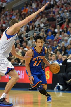 PHILADELPHIA, PA - MARCH 21: Jeremy Lin #17 of the New York Knicks drives around Spencer Hawes #00 of the Philadelphia 76ers at the Wells Fargo Center on March 21, 2012 in Philadelphia, Pennsylvania. NOTE TO USER: User expressly acknowledges and agrees that, by downloading and or using this photograph, User is consenting to the terms and conditions of the Getty Images License Agreement. (Photo by Drew Hallowell/Getty Images)