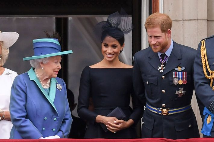 Queen Elizabeth, Meghan Markle, and Prince Harry.