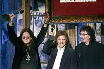 New York, UNITED STATES:  Inductees Ozzy Osbourne, Geezer Butler and Tony Iommi of Black Sabbath after being inducted during the Rock and Roll Hall of Fame Induction Ceremony in New York 13 March 2006. The  Rock and Roll Hall of Fame Museum's permanent collection is in Cleveland Ohio. AFP PHOTO   Timothy A. CLARY  (Photo credit should read TIMOTHY A. CLARY/AFP/Getty Images)