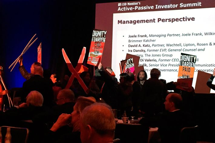 More than two dozen protester holding signs and shouting hedge fund managers' names to protest low wages at fast food restaurants interrupted a hedge fund industry conference in New York April 13, 2015. Shouting