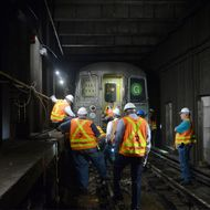 MTA New York City Transit personnel work at the scene of a G train derailment near the Hoyt-Schermerhorn station, as they attempt to restore service late in the evening of Sept. 10, 2015.