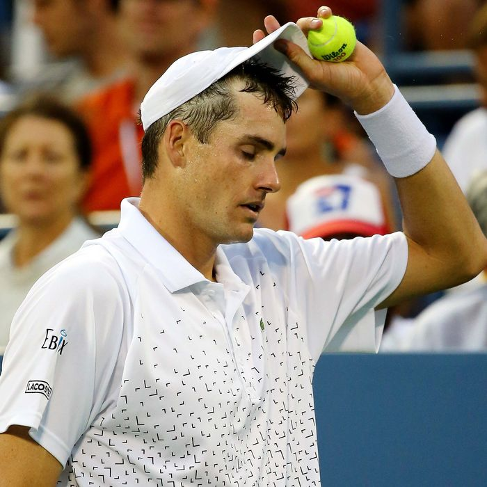John Isner of the United States reacts against Philipp Kohlschreiber of Germany during men's singles third round match on Day Six of the 2014 US Open at the USTA Billie Jean King National Tennis Center on August 30, 2014 in the Flushing neighborhood of the Queens borough of New York City.