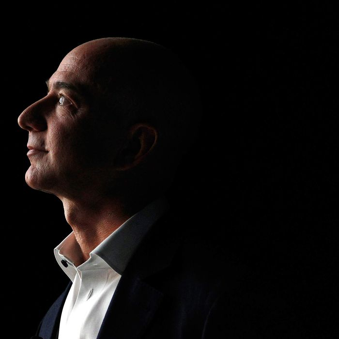 Jeff Bezos, chief executive officer of Amazon.com Inc., watches a video of the new Kindle Fire HD tablet at a news conference in Santa Monica, California, U.S., on Thursday, Sept. 6, 2012. Amazon.com Inc. is updating its line of Kindle e-readers and tablets in a bid to stoke consumer demand as Google Inc. and Microsoft Corp. join the crowded market of machines challenging Apple Inc.'s iPad.