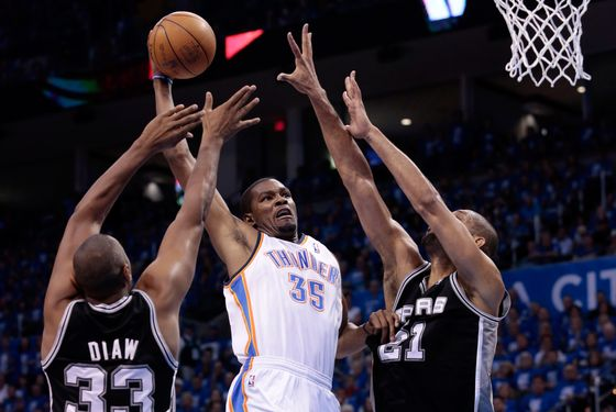 OKLAHOMA CITY, OK - MAY 31:  Kevin Durant #35 of the Oklahoma City Thunder goes up for a dunk between Boris Diaw #33 and Tim Duncan #21 of the San Antonio Spurs in the second quarter in Game Five of the Western Conference Finals of the 2012 NBA Playoffs at Chesapeake Energy Arena on May 31, 2012 in Oklahoma City, Oklahoma. NOTE TO USER: User expressly acknowledges and agrees that, by downloading and or using this photograph, User is consenting to the terms and conditions of the Getty Images License Agreement.  (Photo by Brett Deering/Getty Images)