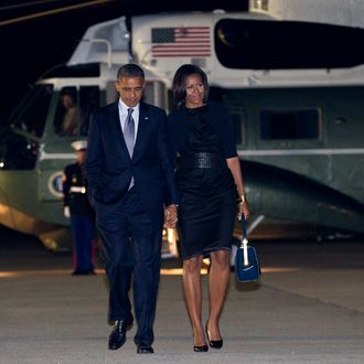 President Barack Obama and first lady Michelle Obama walks from Marine One to board Air Force One at John F. Kennedy International Airport, Friday, June 15, 2012, in Andrews Air Force Base, Md., en route Washington.