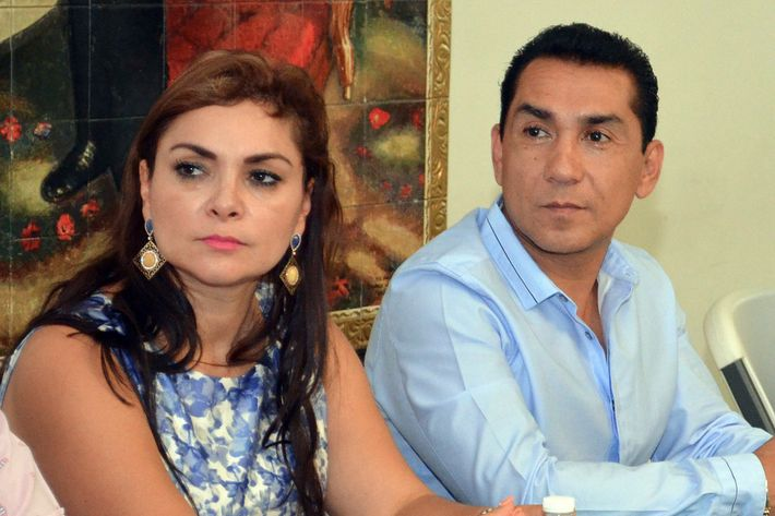 In this May 8, 2014 file photo, the mayor of the city of Iguala, Jose Luis Abarca, right, and his wife Maria de los Angeles Pineda Villa meet with state government officials in Chilpancingo, Mexico. Abarca ordered a police attack that resulted in six deaths and the disappearance of 43 students who remain missing weeks later, the country's top prosecutor, Murillo Karam, said Wednesday, Oct. 22.  Karam also said Abarca's wife has been linked to drug gangs and is now considered a fugitive, along with her husband and the Iguala police chief. (AP Photo/Alejandrino Gonzalez, File)