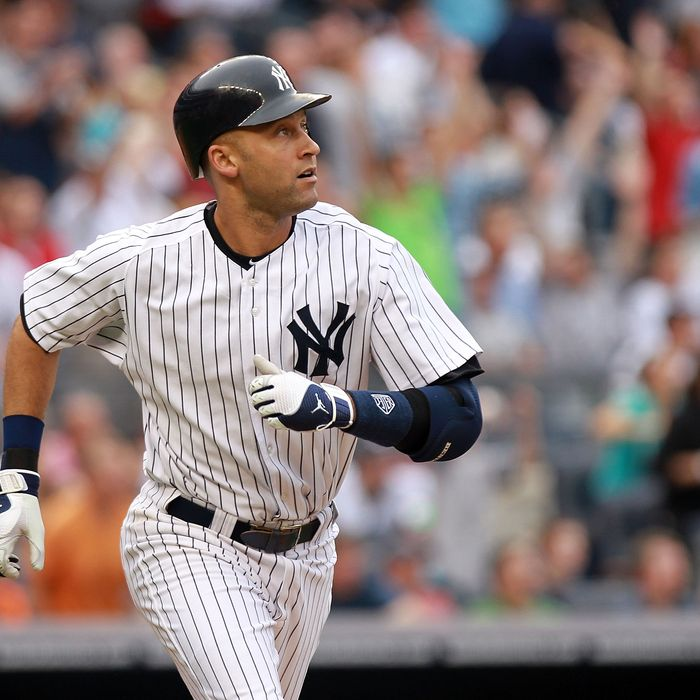 NEW YORK, NY - SEPTEMBER 24: Derek Jeter #2 of the New York Yankees watches his three RBI home run in the second inning against the Boston Red Sox on September 24, 2011 at Yankee Stadium in the Bronx borough of New York City. (Photo by Nick Laham/Getty Images)