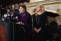 "NEW YORK, NY - NOVEMBER 07:  Sharon Bialek (R) listens as her attorney Gloria Allred (L) speaks during a news conference to accuse Republican presidential candidate Herman Cain of sexual harassment more than a decade ago on November 7, 2011 in New York City. Bialek is the fourth woman to accuse Cain of inappropriate behavior when he was while CEO of the National Restaurant Association. She stated she is speaking out because she wanted to give ""a face and a voice"" to support the other accusers who have remained anonymous.  (Photo by Spencer Platt/Getty Images)"