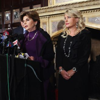 NEW YORK, NY - NOVEMBER 07: Sharon Bialek (R) listens as her attorney Gloria Allred (L) speaks during a news conference to accuse Republican presidential candidate Herman Cain of sexual harassment more than a decade ago on November 7, 2011 in New York City. Bialek is the fourth woman to accuse Cain of inappropriate behavior when he was while CEO of the National Restaurant Association. She stated she is speaking out because she wanted to give
