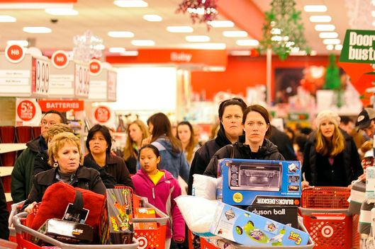 25 Nov 2011, Glenview, Illinois, USA --- epa03014629 Black Friday shoppers fill the aisles at a Target department store as they seek Christmas specials in Glenview, Illinois, 25 November 2011. Black Friday traditionally kicks off the holiday shopping season and gets its name from the day that most businesses target as the day they first turn a profit for the year.  EPA/TANNEN MAURY --- Image by ? TANNEN MAURY/epa/Corbis