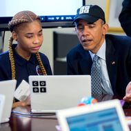 "U.S. President Barack Obama participates in an ""Hour of Code"" event with middle-school students including Adrianna Mitchell in the Eisenhower Executive Office Building next to the White House on December 8, 2014 in Washington, DC.  The event is in honor of Computer Science Education Week. (Photo by Andrew Harrer-Pool/Getty Images)"