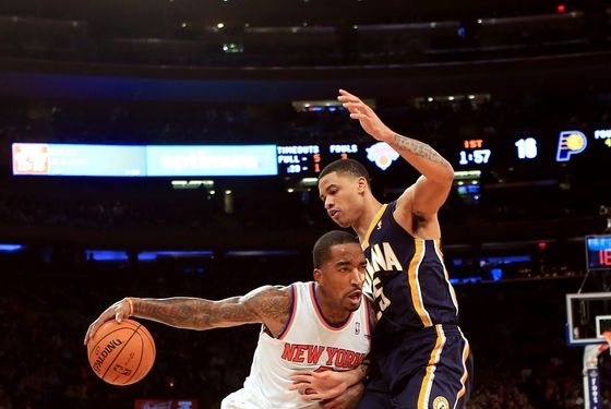 J.R. Smith #8 of the New York Knicks drives in against Gerald Green #25 of the Indiana Pacers at Madison Square Garden on November 18, 2012 in New York City.