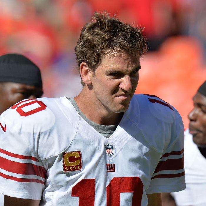 Quarterback Eli Manning #10 of the New York Giants walks off the field after losing to the Kansas City Chiefs 31-7 on September 29, 2013 at Arrowhead Stadium in Kansas City, Missouri.