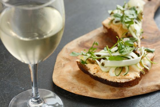 Smoked shrimp toast with pickled ramps, zucchini, and watercress, on She Wolf Bakery's sesame sourdough.