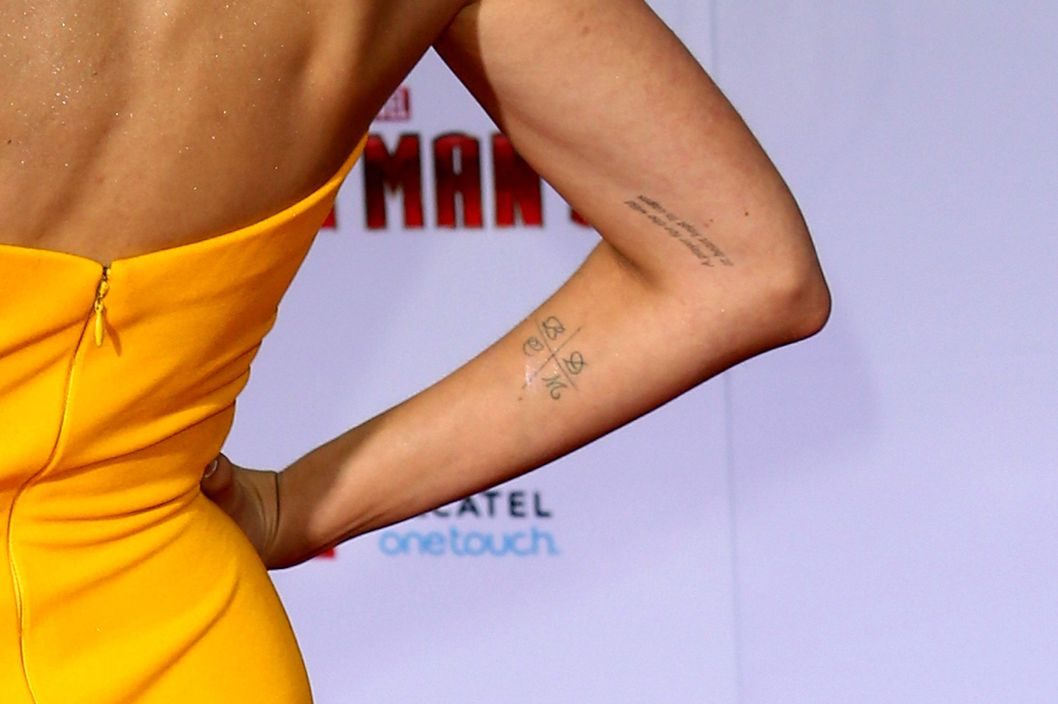 "Actress Jaimie Alexander (tattoo detail) attends the premiere of Walt Disney Pictures' ""Iron Man 3"" at the El Capitan Theatre on April 24, 2013 in Hollywood, California."