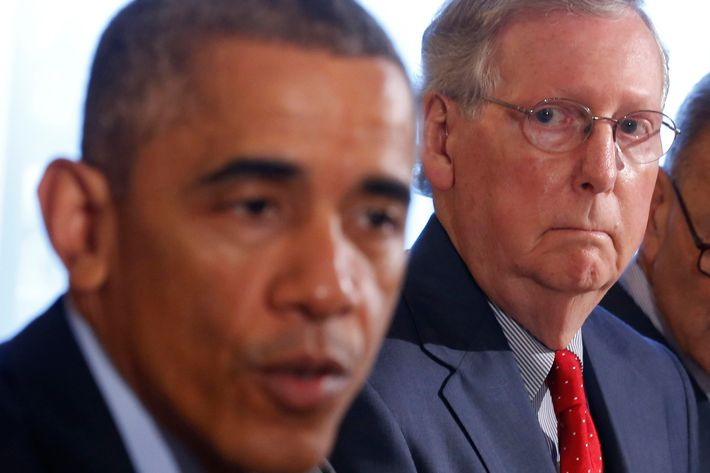 Senate Minority Leader Mitch McConnell listens as U.S. President Barack Obama hosts a luncheon for bi-partisan Congressional leaders in the Old Family Dining Room at the White House in Washington, November 7, 2014.