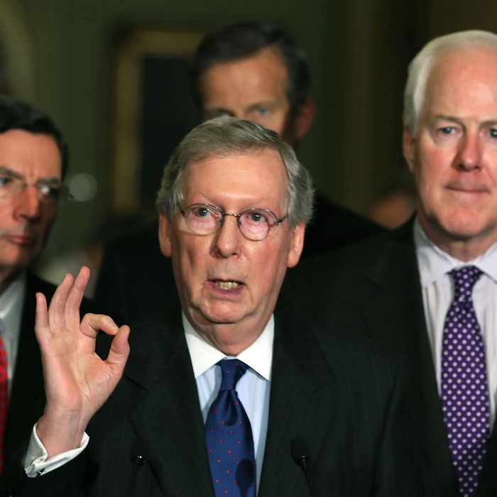 Senate Minority Leader Mitch McConnell (R-KY) (C) speaks to the media while flanked by Sen. John Barrasso (R-WY) (L), Sen. John Cornyn (R-TX) (R) and Sen. John Thune (R-SD) on April 9, 2013 in Washington, DC. The Senators spoke briefly to reporters after attending their Republican policy luncheon.