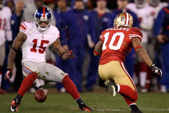 SAN FRANCISCO, CA - JANUARY 22:  Kyle Williams #10 of the San Francisco 49ers fumbles the ball on a punt return in overtime against Devin Thomas #15 of the New York Giants during the NFC Championship Game at Candlestick Park on January 22, 2012 in San Francisco, California.  (Photo by Ezra Shaw/Getty Images)