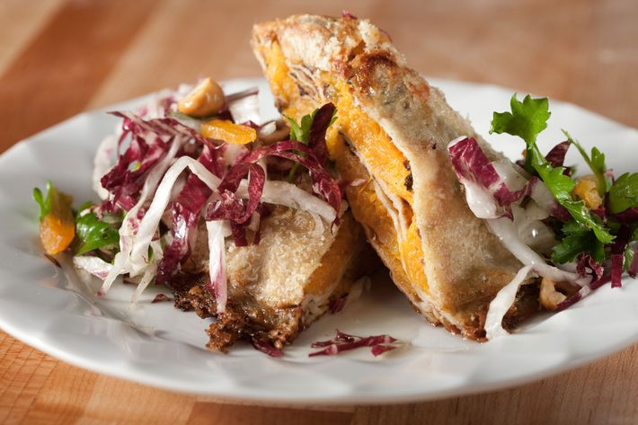 Pumpkin crespelle with Parmesan, radicchio, parsley, dried apricot, and amaretti cookies.