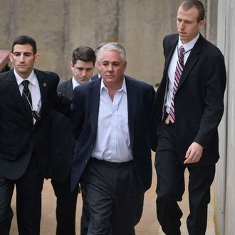 Former Suffolk County Police Chief James Burke is escorted to a vehicle by FBI personnel outside an FBI office in Melville, N.Y. on Wednesday, Dec. 9, 2015. Prosecutors didn't immediately announce charges, but Burke had been under scrutiny for years over an allegation that he beat a prisoner in 2012. He resigned from the force in October. (Steve Pfost/Newsday via AP) NYC LOCALS OUT; MANDATORY CREDIT Newsday photo by Steve Pfost