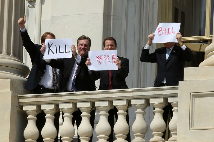 "Members of Congress hold up signs from the second floor of the Capitol that read ""Kill The Bill"" on Capitol Hill on March 21, 2010 in Washington, DC. Later today the  House is scheduled to vote on Health Care Legislation that has divided both sides of Congress."