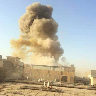 An Islamic State car bomb explodes at the gate of a government building near the provincial governor's compound in Ramadi during heavy fighting that saw most of the city fall to the militants.