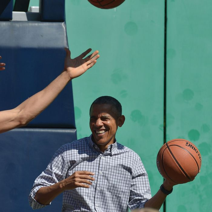 US President Barack Obama plays basketball during the annual Easter Egg Roll on the South Lawn of the White House on April 6, 2015 in Washington, DC.