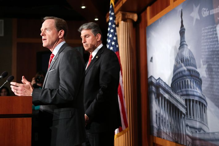 Sen. Pat Toomey (R-PA) (L) and Sen. Joe Manchin (D-WV) speak to the press about background checks for gun purchases, in the U.S. Capitol building April 10, 2013 in Washington DC.  The pair is proposing a bipartisan compromise, a proposal to be voted on as an amendment that would expand background checks to firearms sales at gun shows and on the Internet.