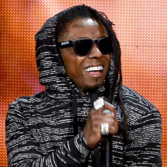 Recording artist Lil Wayne performs onstage at the 2014 American Music Awards at Nokia Theatre L.A. Live on November 23, 2014 in Los Angeles, California. (Photo by Kevin Winter/Getty Images)