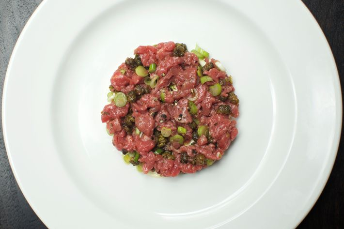 Steak tartare with fried capers, spring onions, and spiced mayonnaise.